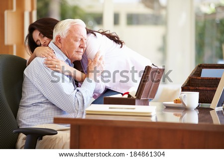 Senior Father Being Comforted By Adult Daughter - stock photo