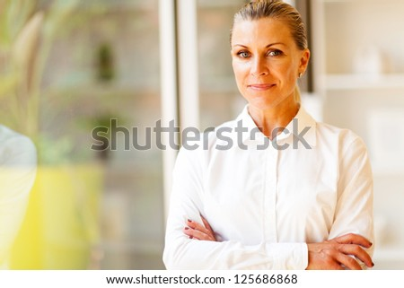 senior female corporate worker in office - stock photo