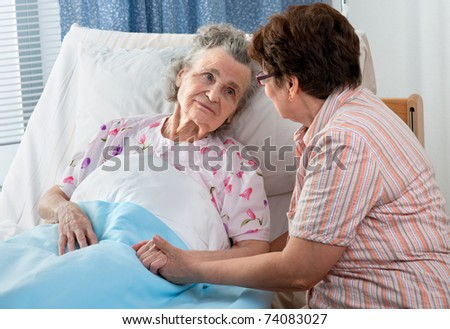 Senior female is being visited by the daughter in hospital