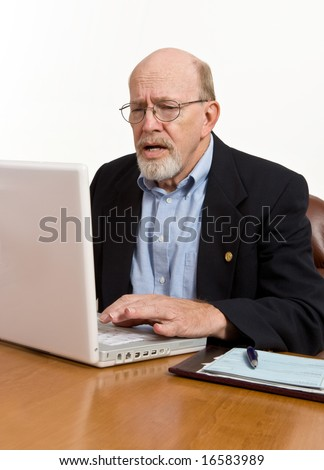 Senior frustrated with his laptop computer and the entire digital world.