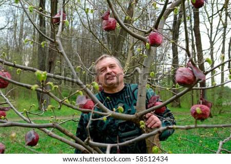 Senior gardener is ready for the job - stock photo