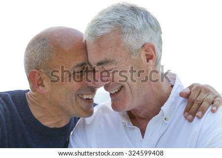 Senior Gay Male Couple Affectionate, Smiling, and in Love - stock photo