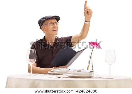 Senior gentleman holding a menu and calling a waiter in a restaurant isolated on white background - stock photo
