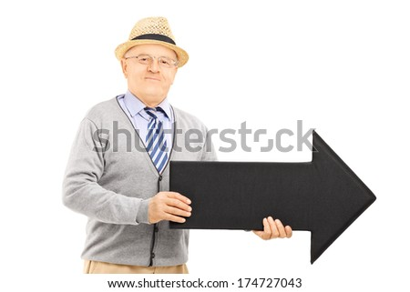 Senior gentleman holding big black arrow pointing right isolated against white background
