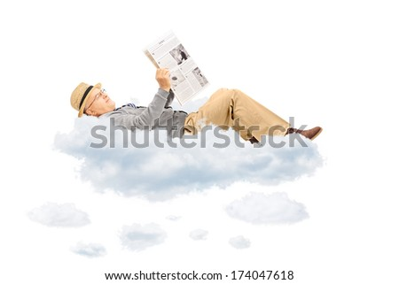 Senior gentleman reading newspaper laying on clouds, isolated on white background - stock photo