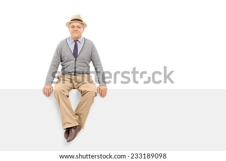 Senior gentleman sitting on a blank billboard isolated on white background - stock photo
