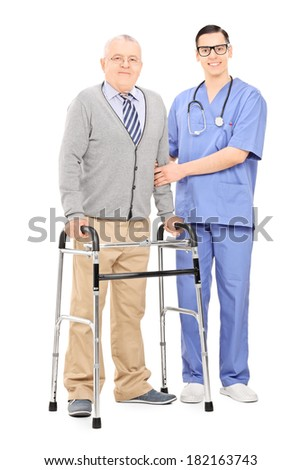 Senior gentleman with walker posing next to doctor isolated on white background