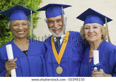 Senior graduates smiling outside, portrait - stock photo