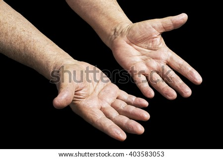 Senior hands on a black background