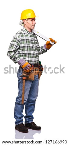 senior handyman with spirit level on white - stock photo