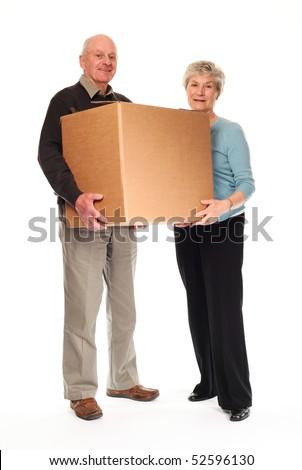 Senior happy couple on white background holding cardboard box together - stock photo