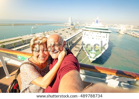 Senior happy couple taking selfie on ship on harbor background - Mediterranean cruise travel tour - Active elderly concept with retired people around the world - Bright sunny afternoon color tones