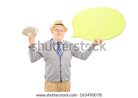 Senior happy gentleman holding an empty speech bubble and us dollars isolated on white background - stock photo