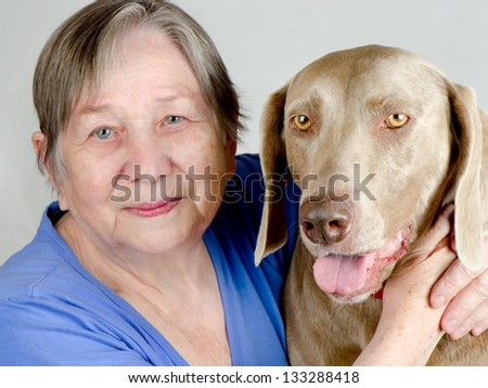 Senior happy woman and dog - stock photo