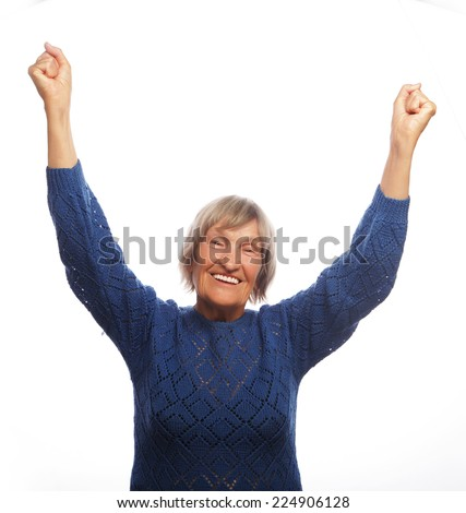 senior happy woman gesturing victory over white background - stock photo