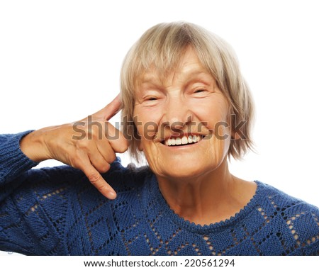 senior happy woman is making a call me gesture, isolated on white - stock photo