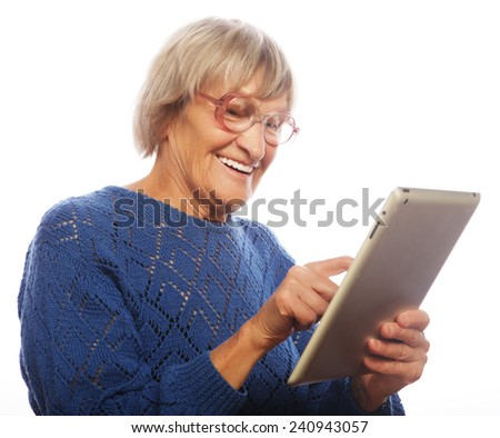 Senior happy woman using computer isolated on white background