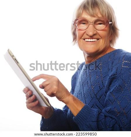Senior happy woman using ipad isolated on white background  - stock photo