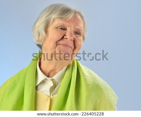 Senior happy woman with grey hairs against blue background.  - stock photo