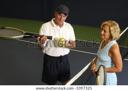 Senior Health and Fitness Tennis Instruction Racket balance