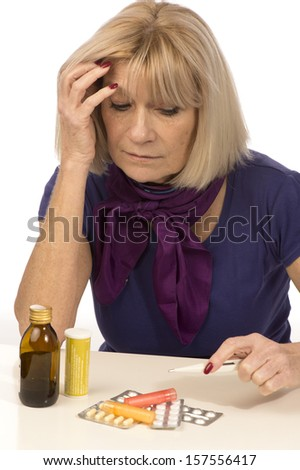 Senior health and medicine-woman having migraine