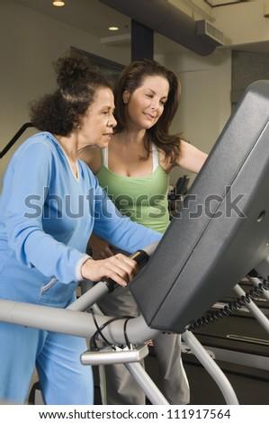 Senior hispanic woman exercising on treadmill - stock photo