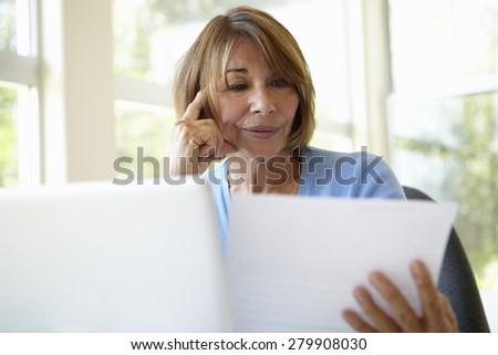 Senior Hispanic Woman Working In Home Office - stock photo