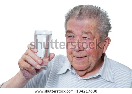 Senior holding a glass of water in hand - stock photo