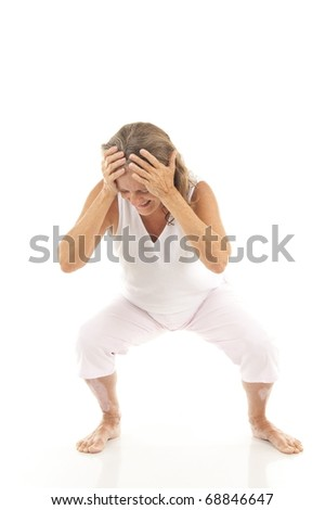 Senior holding her face with pain . - stock photo