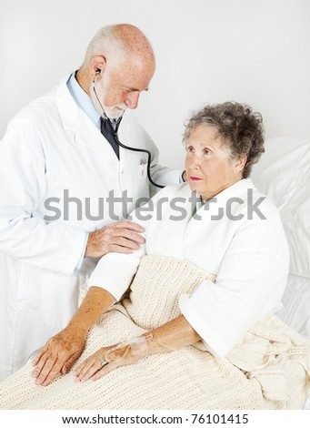 Senior hospital patient gets a thorough medical exam from her doctor. - stock photo