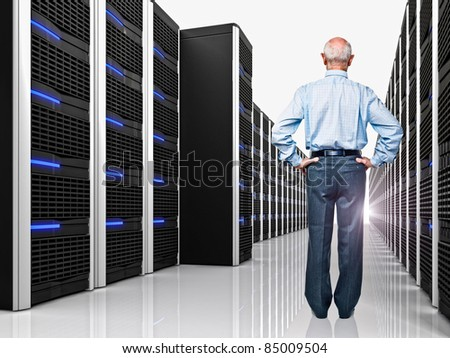 senior in datacenter with lots of server - stock photo