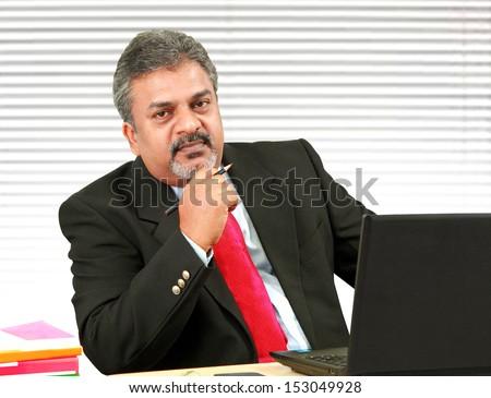 Senior Indian business man - stock photo
