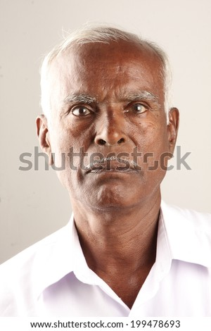 Senior Indian old man serious expression portrait
