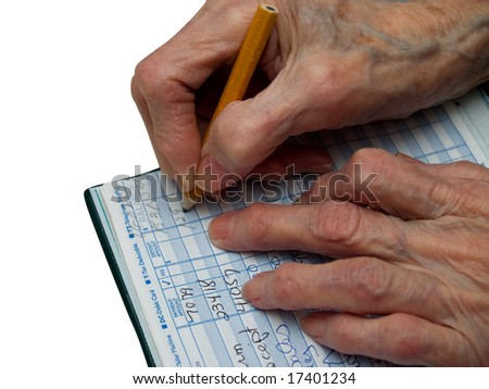Senior is counting her expenses in the checkbook - stock photo