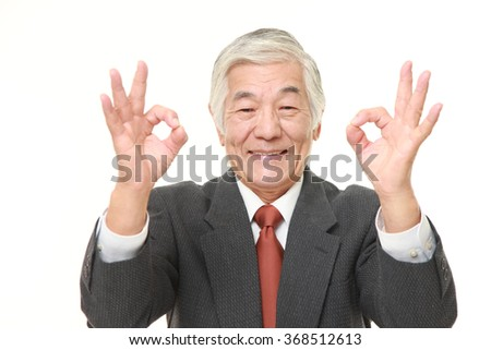 senior Japanese businessman showing double perfect sign