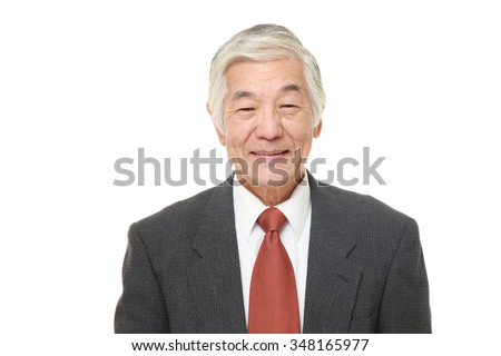senior Japanese businessman smiles