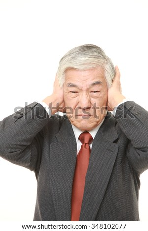 senior Japanese businessman suffers from noise