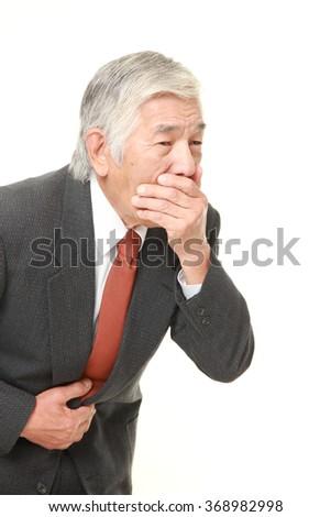 senior Japanese businessman suffers from stomachache? - stock photo