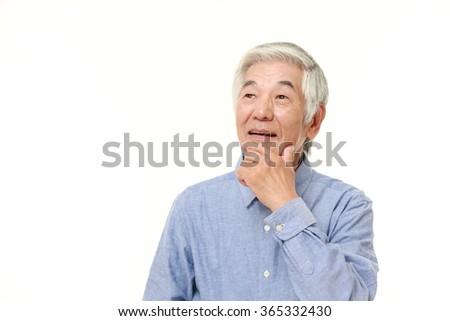 senior Japanese man dreaming at his future? - stock photo