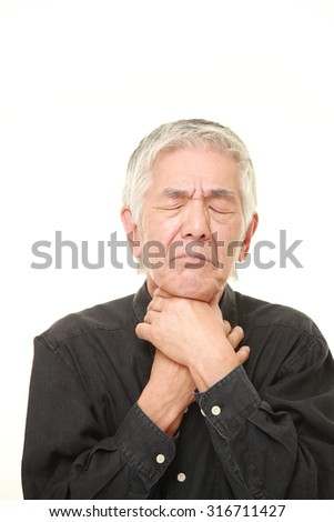 senior Japanese man having throat pain