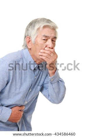 senior Japanese man in a blue shirts feels like vomiting - stock photo