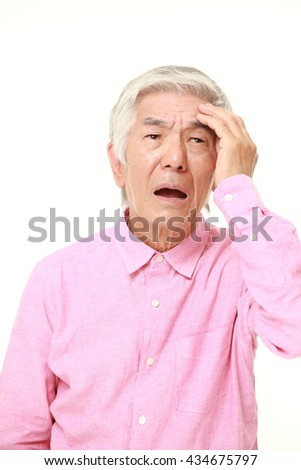 senior Japanese man in a pink shirts has lost his memory