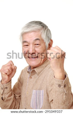 senior Japanese man in a victory pose