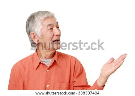 senior Japanese man presenting - stock photo
