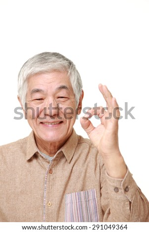 senior Japanese man showing perfect sign