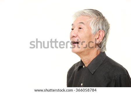 senior Japanese man smiles - stock photo