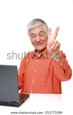 senior Japanese  man using laptop computer - stock photo