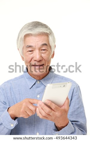 senior Japanese man using tablet computer