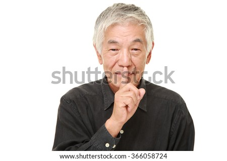 senior Japanese man whith silence gestures - stock photo