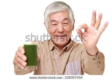 senior Japanese man with green vegetable juice - stock photo